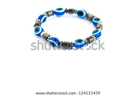 Bracelet with blue eyes isolated on white background.