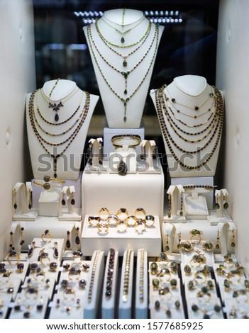 Bracelets, earrings, pendants made of precious Czech garnet stone on display of jewelry store #1577685925