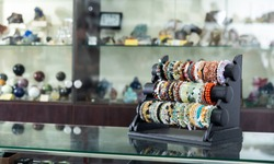 Bracelets made of semiprecious stones on display of jewelry store
