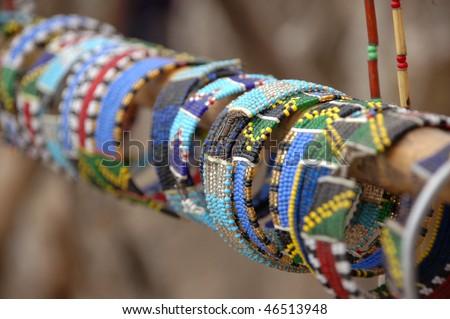 Bracelets shown for sale in local village Massai market , Serengeti, Tanzania