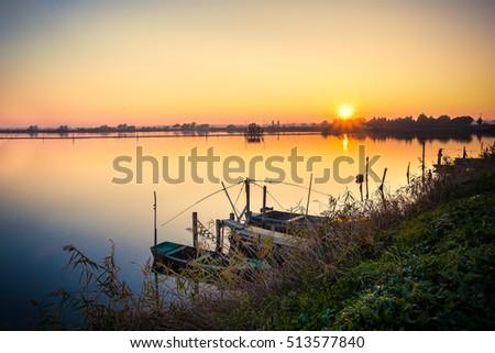 Brackish lagoon sun set over lake