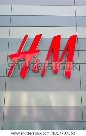 Bracknell, England - February 04, 2018: H & M shop sign on the outside of the fashion store in Bracknell, England. Originally from Sweden, H&M opened their first store in London in 1976 #1017707563
