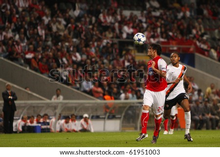 BRAGA, PORTUGAL - SEPTEMBER 28: Braga's defender Luis Aguiar(L), plays the ball with the head near Shakhtar Donetsk (UKR) forwarder Willian in Champions League on September 28, 2010 in Braga, Portugal