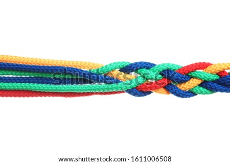 Braided colorful ropes isolated on white. Unity concept