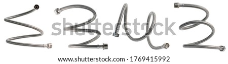 Braided flexible metal hose covered with silicone. Set of hoses twisted in different shapes. Isolated on white background. Stock photo ©