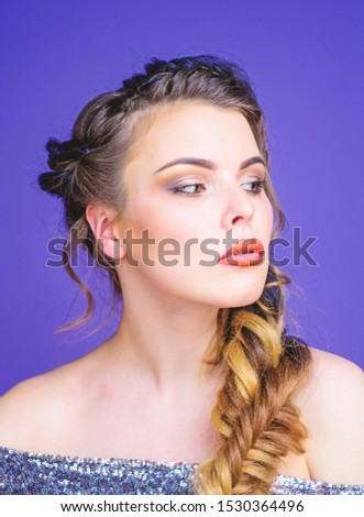 Braided hairstyle. French braid.  Beautiful young woman with modern hairstyle.