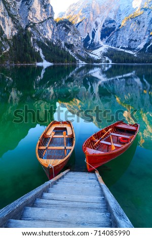 Braies lake and boats in the background of Seekofel mountain in Dolomites,Italy ( Pragser Wildsee )
