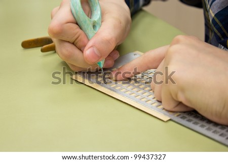 Braille dots - writhing without seeing, writing the letters in braille - stock photo