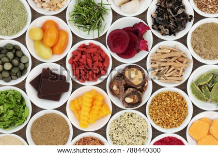 Brain boosting health food selection with fruit, vegetables, bee grain pollen, seeds, dark chocolate, supplement powders with herbs also used in herbal medicine. #788440300