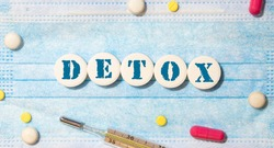 Brain detox concept photo. Word detox of volumetric letters is near 3D brain model and medical stethoscope. Medical diet program for detoxification and cleanse of brain, nerve and nervous system