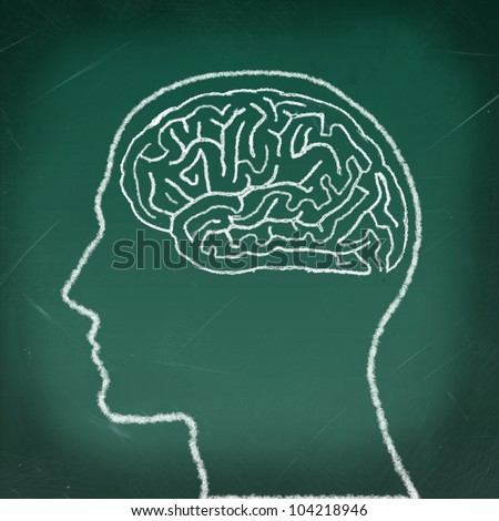 Brain Maze Puzzle, drawing on the chalkboard, a thinking man concept