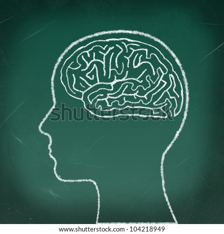 Brain Maze Puzzle, drawing on the chalkboard, a thinking woman concept - stock photo