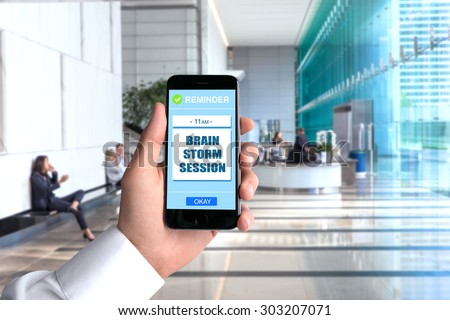 Brain storming storm cell phone smartphone hand POV business man background workplace office perspective point of view executive
