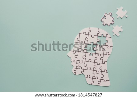 brain with puzzle paper cutout, autism, memory loss, dementia and alzheimer awareness, world mental health day concept