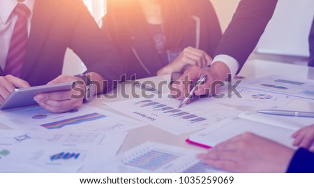 Brainstorm partnership of people Working for business plan Concept. Business team work brainstorming make a marketing plan research.discussing with chart paperwork document, laptop and mobile phone