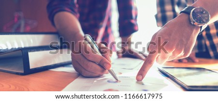 Brainstorm partnership of people Working for business plan Concept. Business team work brainstorming make a marketing plan research.discussing with chart paperwork document, laptop and mobile phone #1166617975