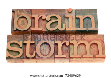 brainstorm word in vintage wood letterpress printing blocks, stained by color inks, isolated on white - stock photo