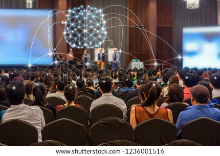 Brainstorming concept of Rear view of Audience and Speaker on the stage in the conference hall or seminar meeting, business and education with technology concept