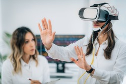 Brainwave EEG Experiment in Neuroscience Research Laboratory. Female Patient Using VR or Virtual Reality Goggles