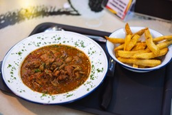 Braised Beef Cheeks Stew with homemade frenchfries