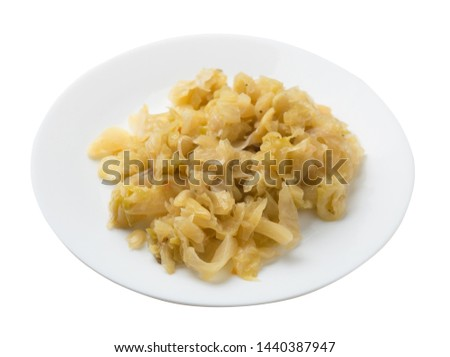 braised cabbage in white  plate isolated on white background. braised cabbage top side view .healthy food. vegetarian food