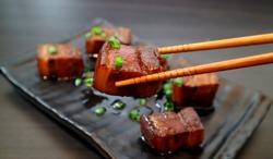 Braised pork belly oriental style food appetizer on dark background. Selective focus.