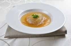braised shark's fin thick soup in round plate and table cloth
