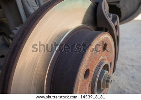 Brake disc and car caliper. The picture with the wheel removed for tire #1453918181