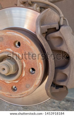Brake disc and car caliper. The picture with the wheel removed for tire #1453918184