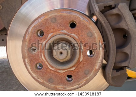 Brake disc and car caliper. The picture with the wheel removed for tire #1453918187