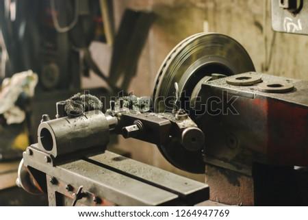 Brake disc grinding machine working. #1264947769
