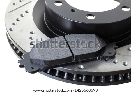 brake discs and pads on a white background. Auto shop