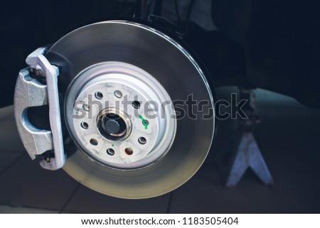 Brake disk and detail of wheel hub #1183505404