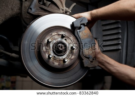 brake pads repairing by car mechanic