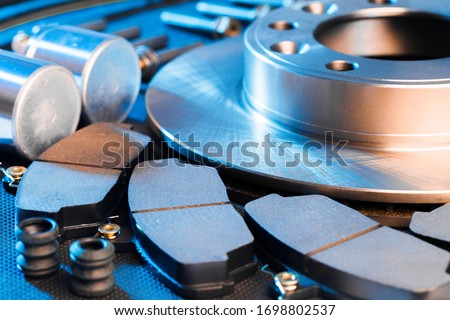 brake parts on dark background  brake pads, disc, brake hose, guides, cylinders Сток-фото ©