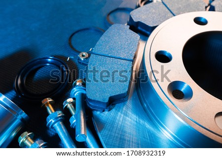 brake parts on dark background  brake pads, disc, brake hose, guides, cylinders