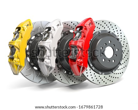 Braking system. Car brake disks with different perforations and calipers  isolated on white background. 3d illustration Сток-фото ©