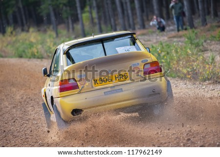 BRAMSHILL FOREST, UK - NOVEMBER 3, 2012: Tony Bird driving a Ford Escort Cosworth on the Warren stage of the MSA Tempest Rally in Bramshill Forest, UK on November 3, 2012