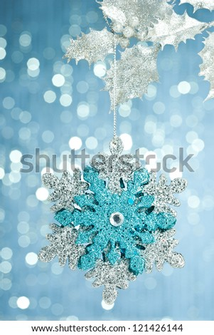 branch of Christmas tree with decoration snowflake