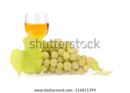 Branch of grapes and glass of wine isolated on white background
