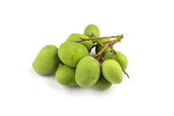 Branch of raw mango and small balls placed on a white background.
