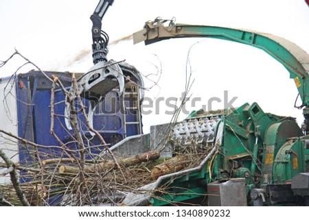 Branching machine, crane, crushing a branch in farm #1340890232