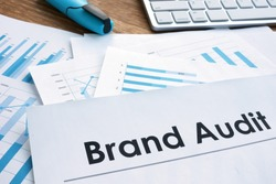 Brand audit report, documents and keyboard.