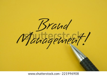 Brand Management! note with pen on yellow background