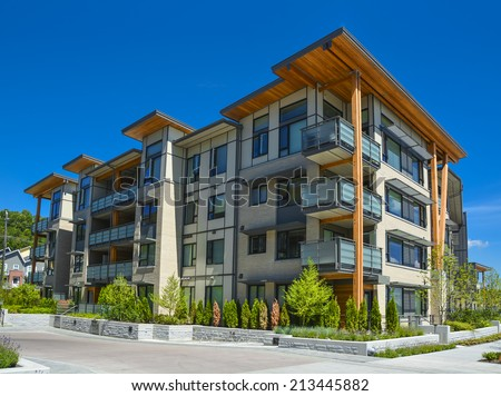 stock-photo-brand-new-apartment-building-on-sunny-day-in-british-columbia-canada-213445882.jpg