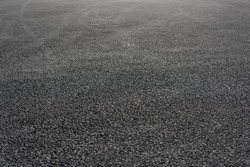 Brand new asphalt pavement low angle background