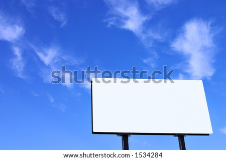 Brand new billboard and a brilliant blue sky with wispy clouds.