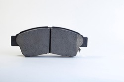 Brand new brake pads for a car on a white background. Brake pad - part of the brake system and its main working component