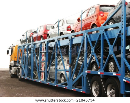 Brand-new cars on a car transport truck at Rosario city, Argentina, near the factory #21845734
