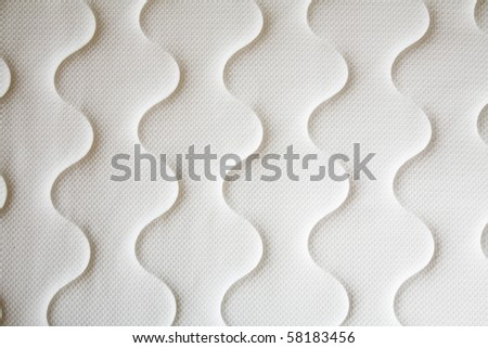 brand new clean spring mattress surface - stock photo